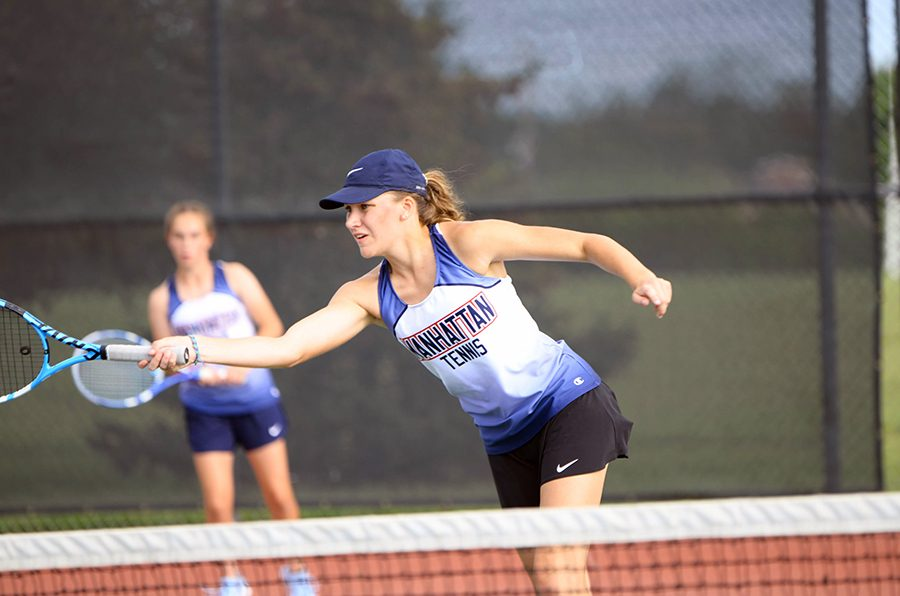 Senior Kate McGee passes the ball over the net during one of her doubles matches on Sept. 14. McGee played with freshman Maura Weins and they scored 1-3, ultimately taking eighth place.