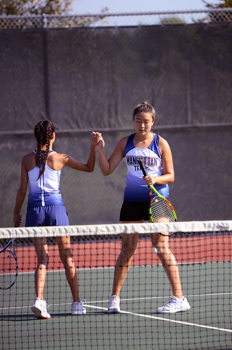 Senior+Joanna+Park+high-fives+sophomore+Hannah+Loub+during+their+Varisty+doubles+match.+The+two+placed+ninth+with+a+score+of+3-1%2C+contributing+to+the+team%27s+overall+placement+of+third.+