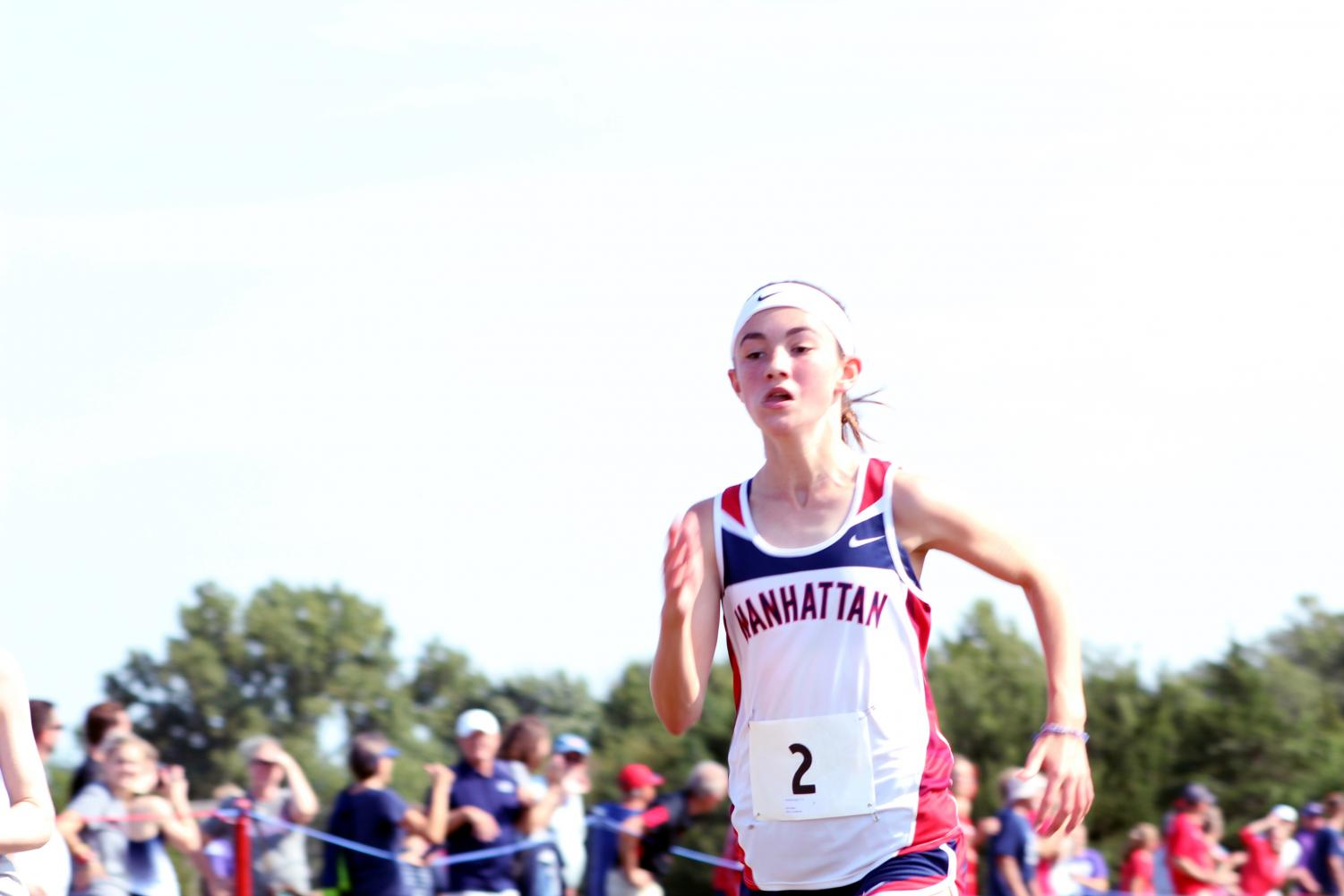 Freshman Amelia Knopp barrels toward the finish line, leading as Manhattan's second runner. Knopp placed third with a time of 20:43.9, having ran a 5K at the Warner Park meet on September 7.
