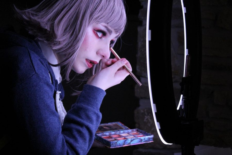 Junior Teagan Hitchings stands in front of a ring light while doing her eyeshadow for a cosplay. Hithcings uses her skills to gain followers on her TikTok account, which she says helps broaden her creativity.