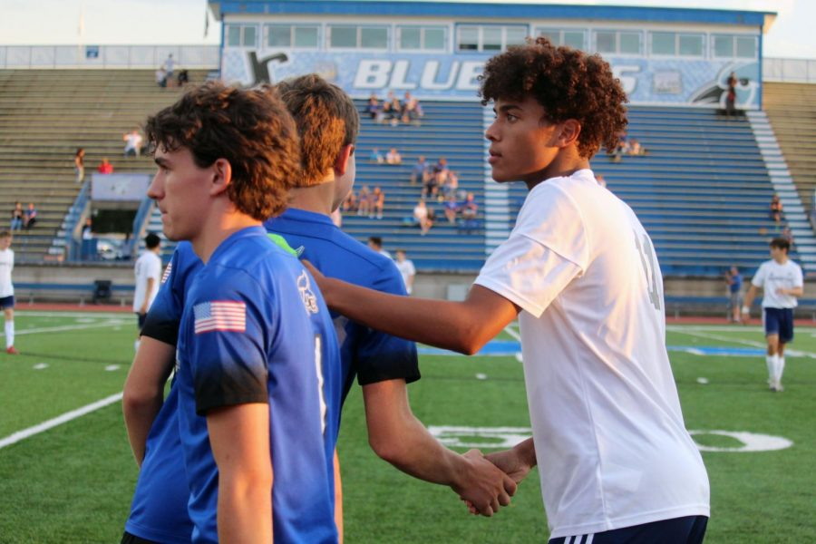 Junior+Gabe+Effiong+shakes+hands+with+Junction+City+team+players.+Effiong+scored+the+seventh+goal+--+his+first+of+his+Varisty+career+--+on+Thursday.+Manhattan+High+beat+J.C.+10-0+with+30+minutes+till+game.