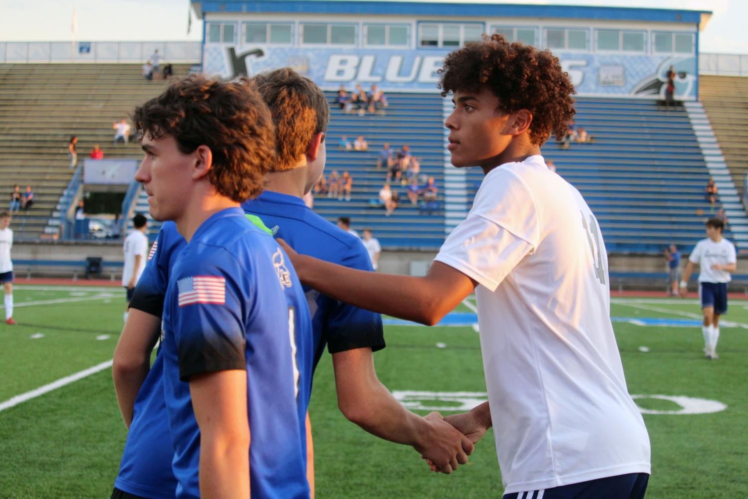 Junior Gabe Effiong shakes hands with Junction City team players. Effiong scored the seventh goal -- his first of his Varisty career -- on Thursday. Manhattan High beat J.C. 10-0 with 30 minutes till game.