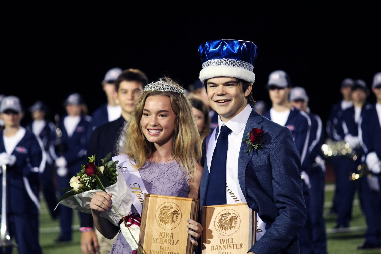 Seniors+Kira+Schartz+and+Will+Bannister+stand+arm-in-arm+as+they+display+their+Homecoming+crowns.+The+two+were+crowned+at+the+football+game+on+Sept.+20+ad+MHS+took+on+Seaman+High.