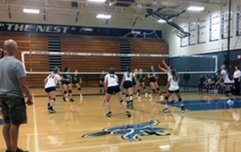 The J.V. volleyball teams plays their set in the J.C. Invitational.