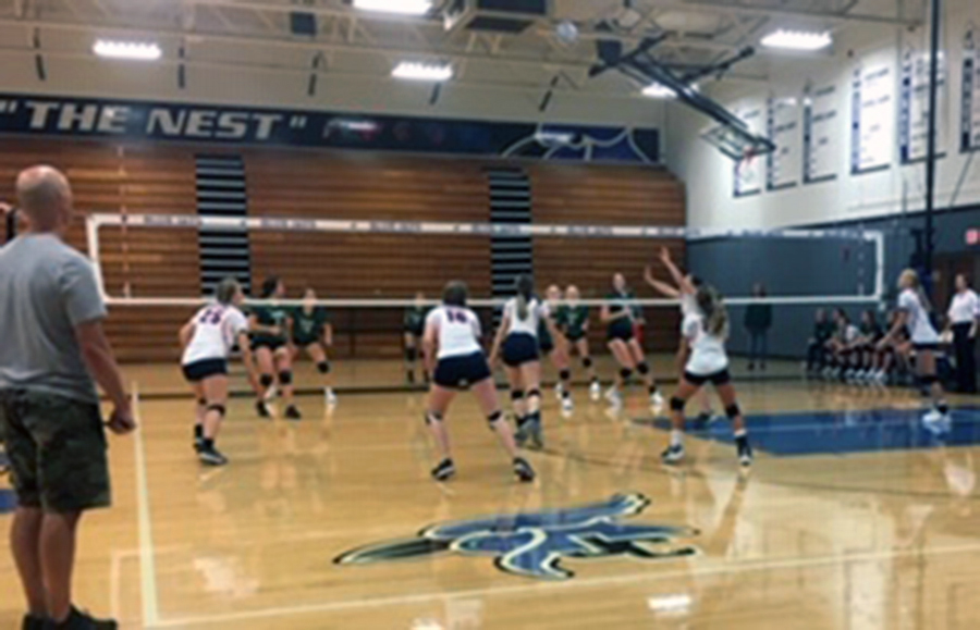The+J.V.+volleyball+teams+plays+their+set+in+the+J.C.+Invitational.