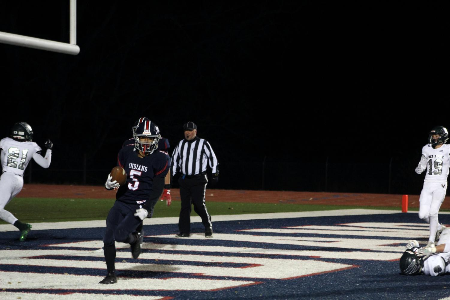 Junior+Lorrenzo+Wilhoite+jogs+out+of+the+endzone+after+securing+a+touchdown+agianst+Lawrence+Free+State.+The+game%2C+which+took+place+on+Nov.+8%2C+led+to+the+team+taking+the+Regional+title+yet+again%2C+leading+them+further+into+the+season+at+Derby.