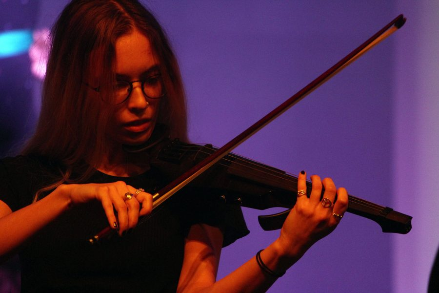 Senior Grace Hart focuses on playing her viola solo for the attentive crowd.  The orchestravaganza  took place last Thursday and Friday in Rezac Audiroium