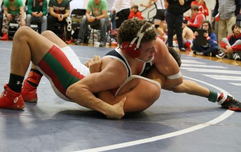 Wrestling takes first at home meet
