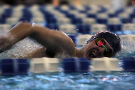 Senior Egan Dritz swims free style at the Topeka Invitational.