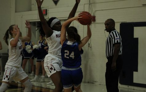 Senior Zanaa Cordis stands tall while defending a player from Washburn Rural. The game was played on Jan. 7 at MHS.