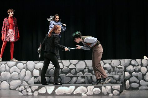 "Senior Ivy Auletti stabs junior Max Barbe during their scene in ""She Kills Monsters."""
