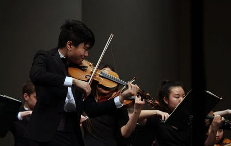 Senior Allen Zhang plays intensely to Shostakovich's String Quartet No. 8, which is meant to express both the sadness and anger he felt during the World War II era. His self-written requiem required that the Chamber Orchestra play aggressively, resulting in broken bow strings.