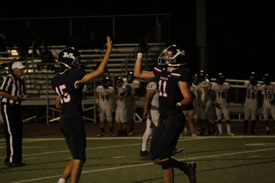 Juniors Grant Snowden and Trey Holloway high five each other after another Tribe touchdown. MHS put up seven on the night in a dominating 42-6 win.