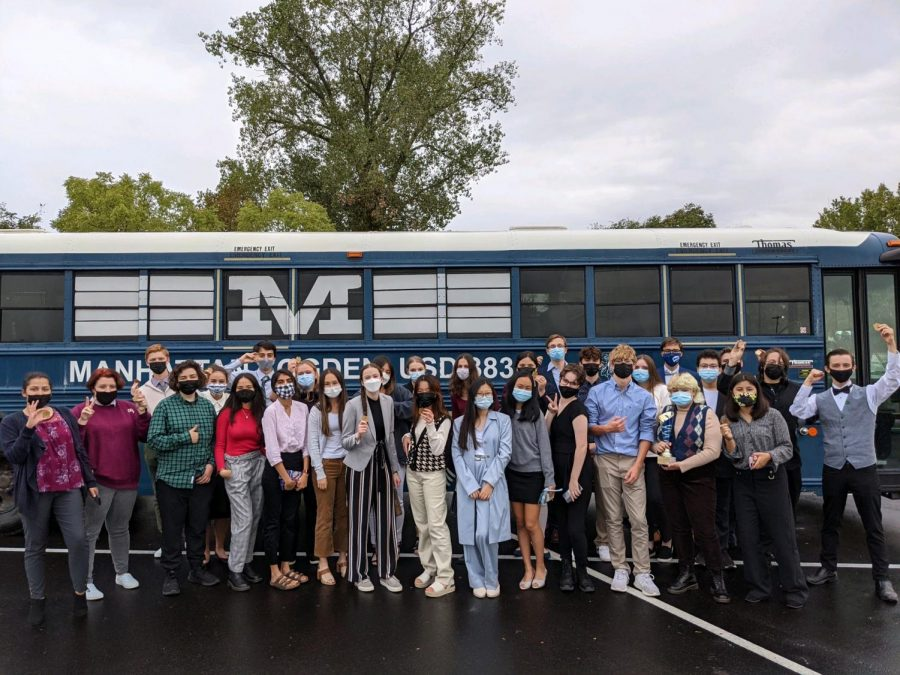 The Manhattan High Debate team lines up against their transportation bus. Overall, the team placed first at the USD 345 HS Fall Classic Debate Tournament. Photo by Carmello Streckfus
