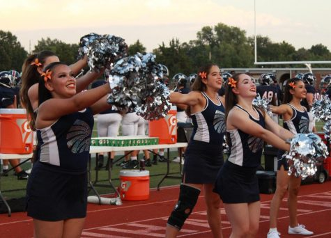 The dance team cheers on the Manhattan High football team in their game against Highland Park on Sept. 7. Photo by Antonio Combs