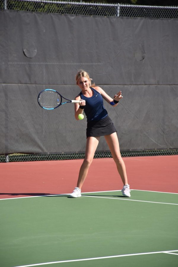 Junior Jillian Harkin sends the ball across the tennis court at State. Harkin won the 6A State Championship on Saturday. Photo courtesy of Gerald Wiens