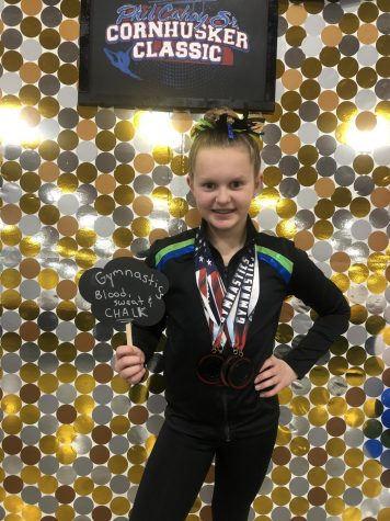 Freshman Emma Crouch, then 12 years old, poses with her winnings at the Phil Cahoy Sr. Cornhusker Classic. Photo courtesy of Jamie Crouch